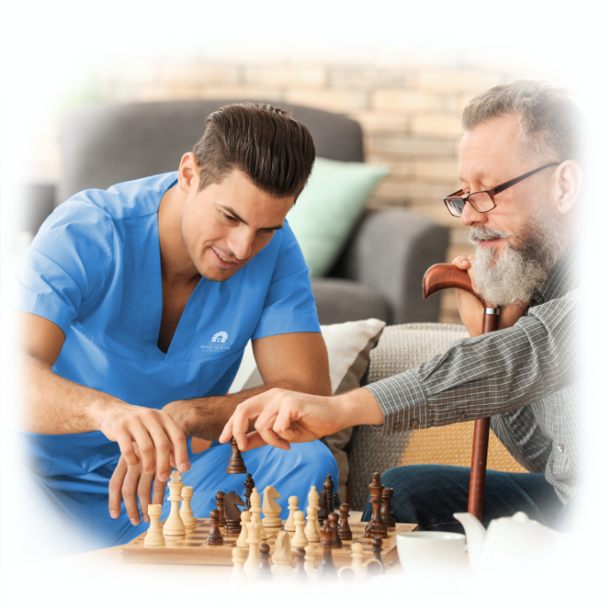 Caregiver playing chess with senior
